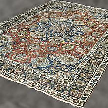 CARPET: HANDWOVEN PERSIAN TABRIZ - Wool on a cotton warp with multi-lobed central floral medallion surrounded by numerous floral, pa...