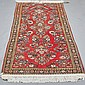 CARPET: HANDWOVEN PERSIAN SAROUK - Wool on a cotton warp with multiple floral sprays and central floral device on a traditional red...