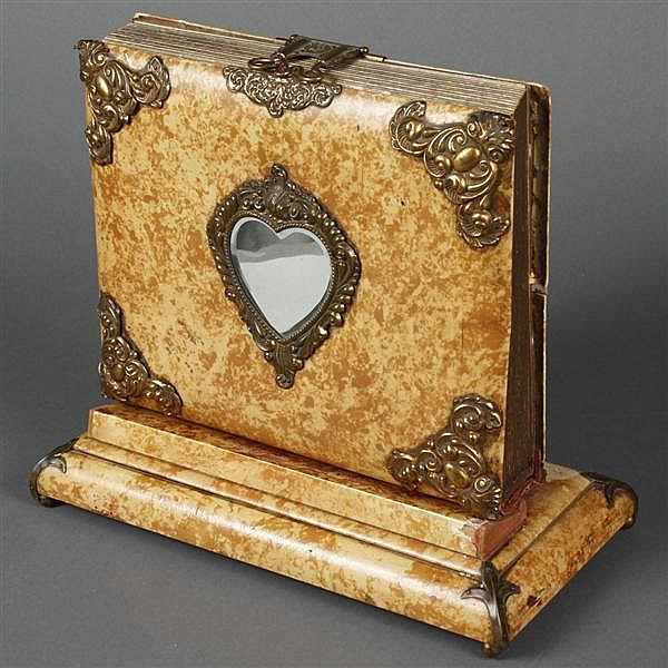 VICTORIAN PHOTO ALBUM - Standing Victorian photo album with faux marble finish, metal mounts and a beveled heart-shaped mirror. The....