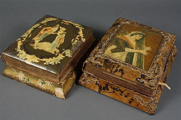 TWO VICTORIAN CELLULOID MUSIC BOX PHOTO ALBUMS - One depicts a couple in early 19th century costume with a circle of forget-me-nots....