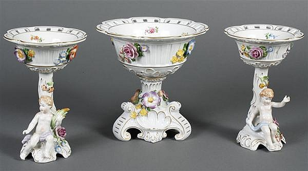 THREE VON SCHIERHOLZ PORCELAIN COMPOTE BOWLS - A central centerpiece compote with two smaller figural compotes; all are encrusted wi...