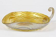 GOLD FAVRILE LEAF FORM DISH - Shaped form with undulating wave pattern and applied furled and ribbed handle. Signed LCT on base. Con...