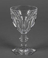 EIGHT BACCARAT CUT CRYSTAL WINE GLASSES - In the Harcourt pattern having cut panels on the bowl and a multi-sided foot. Marked Bacca...