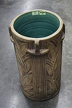 AMERICAN ART DECO UMBRELLA STAND (Two of two) - Decorated with vertical lines and geometric leaf pattern and four rudimentary handle...
