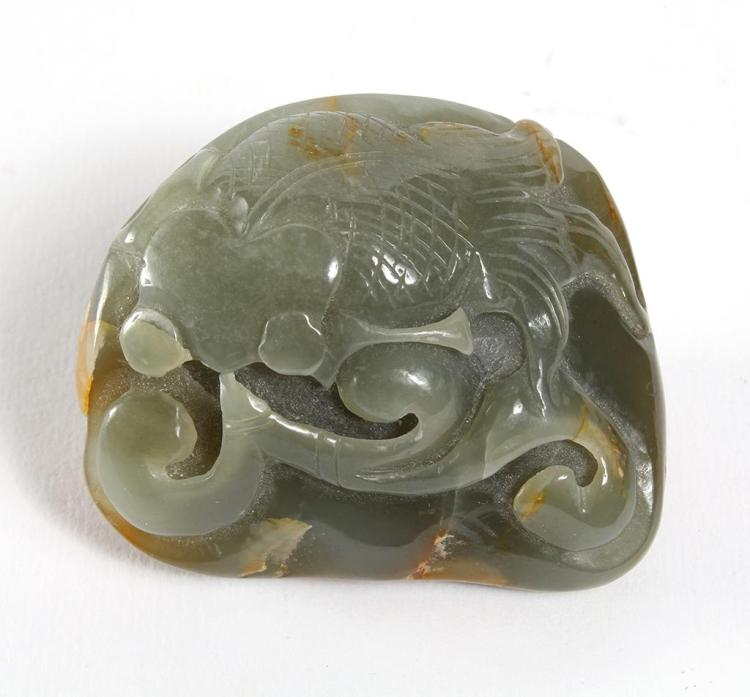 Beautiful jade goldfish a polished stone with relie