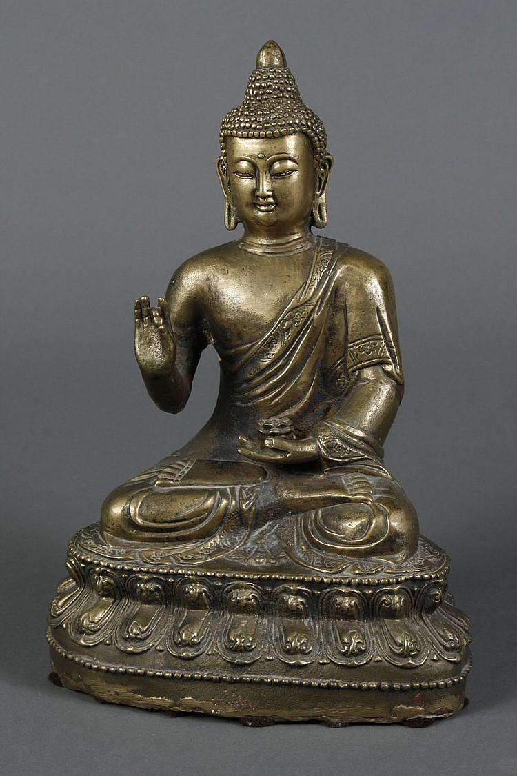 SEATED BRASS BUDDHA - Seated cast brass Buddha with snail shell hair and in the Abhaya mudra with lotus. Condition good. 12