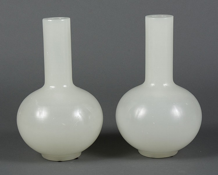 TWO PEKING GLASS VASES - Two globular shaped translucent vases with cylindrical necks. Condition good. 12