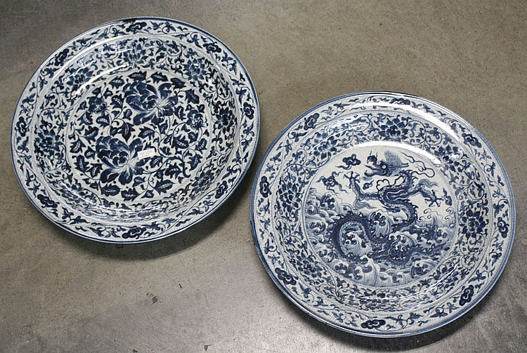 TWO CHINESE LOW BOWLS - Two Chinese ceramic blue and white low bowls. One depicts a dragon and the other an overall botanical design...