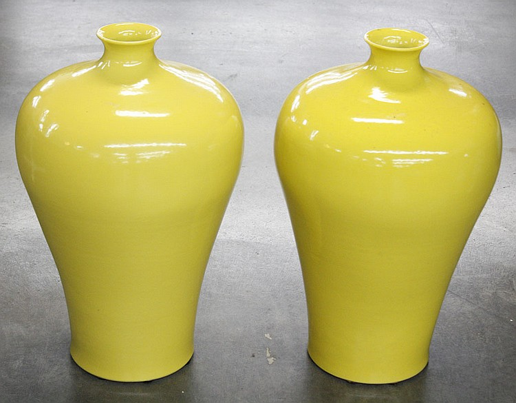 PAIR OF CHINESE PORCELAIN VASES - Pair of Mei Ping shaped yellow porcelain vases. Condition good. 23