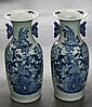 PAIR OF BLUE AND WHITE PORCELAIN VASES - Displays phoenix and peonies; with handles. Condition good. 32