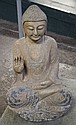 SEATED STONE BUDDHA - Seated Buddha, dark gray ground with tan overglaze depicted in the Abhaya mudra and with snail shell hair