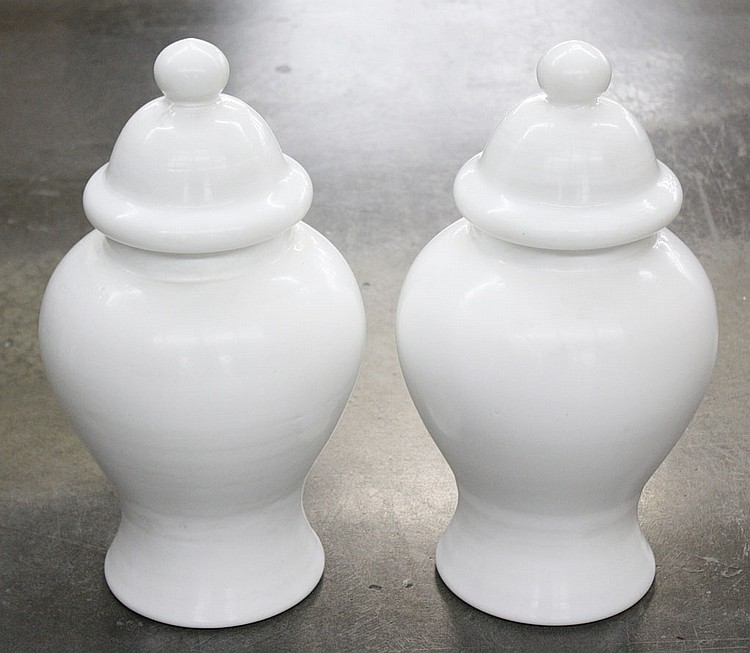 PAIR OF PEKING GLASS GINGER JARS - White glass ginger jars with covers. Condition good; 20th century. 17.5
