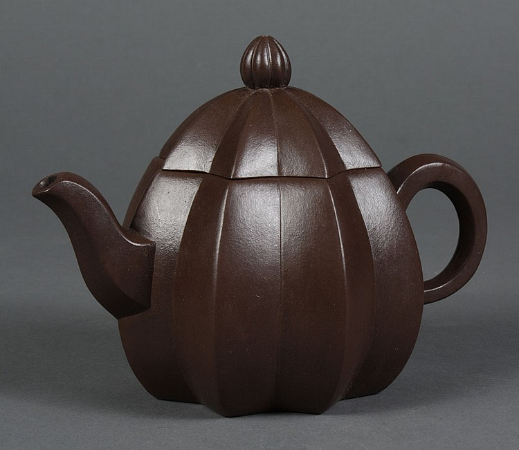 CHINESE YI XING CLAY TEA POT - Dark brown with exaggerated ribbed fluting similar to a pumpkin form; with cover. Character stamp to....