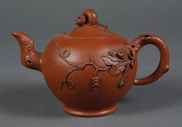 CHINESE YI XING CLAY TEA POT - Reddish brown with raised design of a lady bug, leaves and berries; a squirrel with a bushy tail is o...