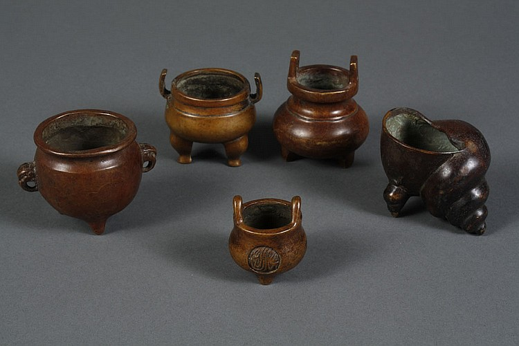COLLECTION OF FIVE CHINESE BRONZE CENSERS - Small tripod censers primarily round in shape; one snail shell shape with two shell shap...