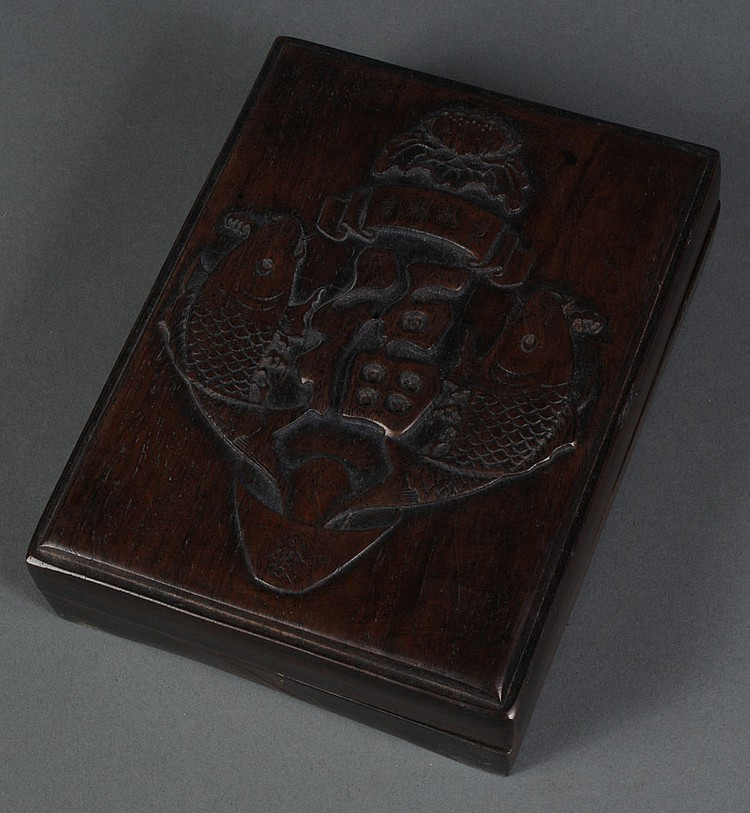 CHINESE INKSTONE IN CARVED WOODEN BOX - Inkstone with calligraphy resides in a wooden box which has a carving of fish and symbols on...