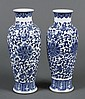 PAIR CHINESE PORCELAIN BLUE AND WHITE VASES - Baluster shape with short neck; overall blue and white foliate and tendril design. Con...