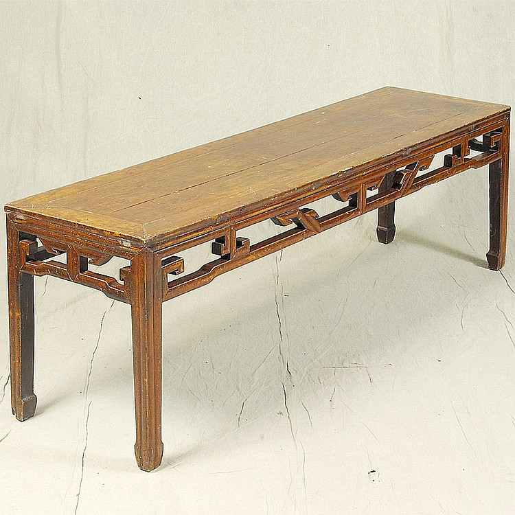 LOW TABLE - Antique Chinese elmwood with rectangular top, open work lattice-style skirting and straight legs with stylized ox-hoof f...