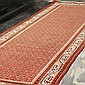 CARPET: HANDWOVEN PERSIAN TABRIZ MIR - Wool on a cotton warp with red field, and an all-over boteh pattern inside a series of geomet...