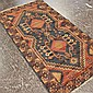 CARPET: HAND-KNOTTED PERSIAN LURI - Wool on wool warp carpet with black field, twin serrated medallions surrounded by floral and geo...