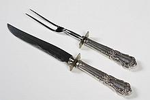 STERLING SILVER CARVING SET - Hollow weighted handled carving knife with stainless steel blade and a carving fork with stainless ste...