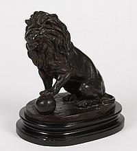BRONZE OVER PLASTER CAST LION - Medici style sitting lion with a sphere under one paw. On a metal and composite oval platform. Appar...