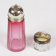 TWO VICTORIAN ITEMS - CRANBERRY GLASS SUGAR SHAKER; GLASS AND PORCELAIN INKWELL - Sugar shaker has a ribbed body and silver cap stam...