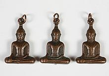 THREE BRONZE BUDDHA AMULETS - Seated Buddha in the Bhumisparsha mudra; also known as the