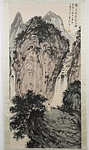CHINESE SCROLL - Watercolor on paper depicting a landscape with a figure, mountains and a waterfall. Condition good; minor paper dam...