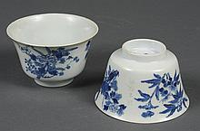 PAIR CHINESE PORCELAIN B/W TEACUPS - Decorated with flowers and foliage. Four character mark to base. Condition good; several minor...