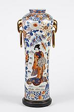 LARGE JAPANESE IMARI STYLE PORCELAIN VASE - Elongated cylinder form with high shoulders; having rudimentary elephant handles with ov...