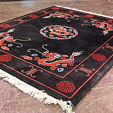 CARPET: HANDWOVEN CHINESE TRADITIONAL - Wool on a cotton warp with central coin style medallion, large-scale dragon designs and latt...