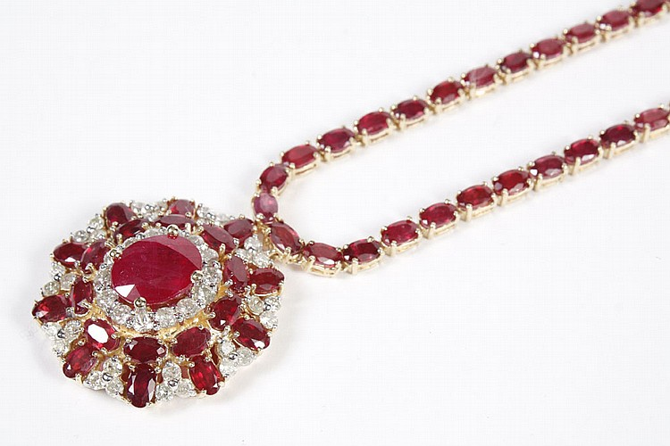RUBY AND DIAMOND NECKLACE AND PENDANT - A stylized prong-set ruby and diamond floret pendant with a central natural mixed cut oval r...