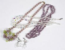 THREE VINTAGE NECKLACES AND EARRINGS - Comprising a two-strand necklace of aurora borealis crystal (17