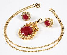 RUBY AND SAPPHIRE PENDANT AND EARRINGS - The yellow gold over silver pendant features a round red ruby 9/16