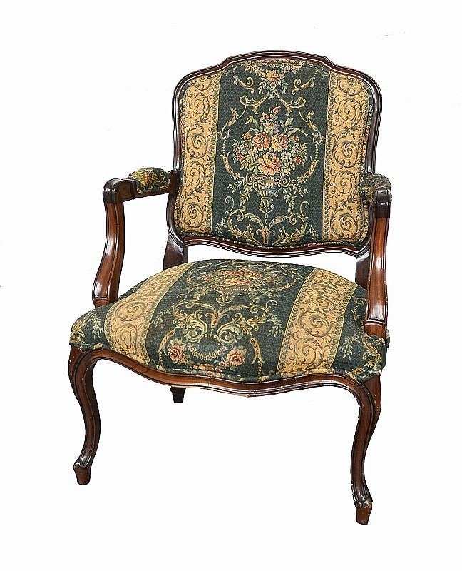Carved wood and fabric armchair.