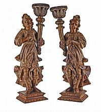 Pair of Seraphim in craved and paited wood, 18th century.