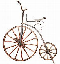 19th century, circa 1870/80, wood, iron and leather Boneshaker Children's bike.Note: private collection Dr. António Augusto Conde.