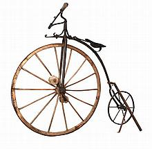 19th century, circa 1870/80, wood, iron and leather Boneshaker bike.Note: private collection Dr. António Augusto Conde.