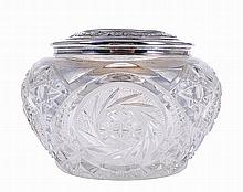 Crystal box with silver cover.