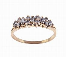 Yellow gold ring set with 13 brilliant cut diamonds with aprox. Weight: 0.50cts.