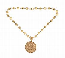 Portuguese gold Viana necklace with circular gold filigree medallion.