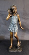 BRONZE FOUNTAIN OF GIRL HOLDING SHELL TO EAR