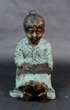 BRONZE STATUE OF GIRL SITTING DOWN READING BOOK
