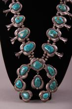 Rare Native American Squash Blossom Silver and Turquoise Necklace with the highest quality of turquoise stones.  Worn by the Chief of the Seminole Indians Joe Dan Osceola.  Comes with C.O.A.  Very large necklace. X-ray Silver tested.  (Size: See