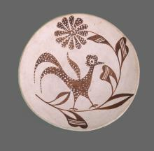 Southwest Native American Indian hand painted plate of bird an flowers.