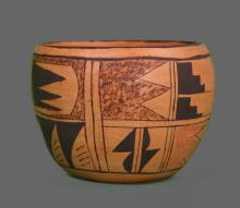 1900's South West Native American Hopi pottery vase decorated in geometric motifs in black, tan and orange, signed on underside,