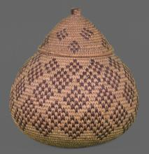 Native American or Oceanic bottleneck weaved basket from early 1900's, finely shaped and tightly woven. Early 1900's from Seminole Chief Joe Dan Osceola's museum collection. Measurements 12 (in) x 11(in). A very significant Native American artifact