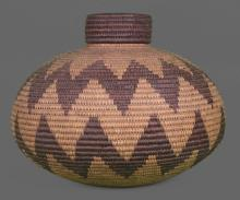 Native American or Oceanic bottleneck weaved basket from early 1900's, finely shaped and tightly woven. Early 1900's from Seminole Chief Joe Dan Osceola's museum collection. Measurements 12 (in) x 14(in). A very significant Native American artifact