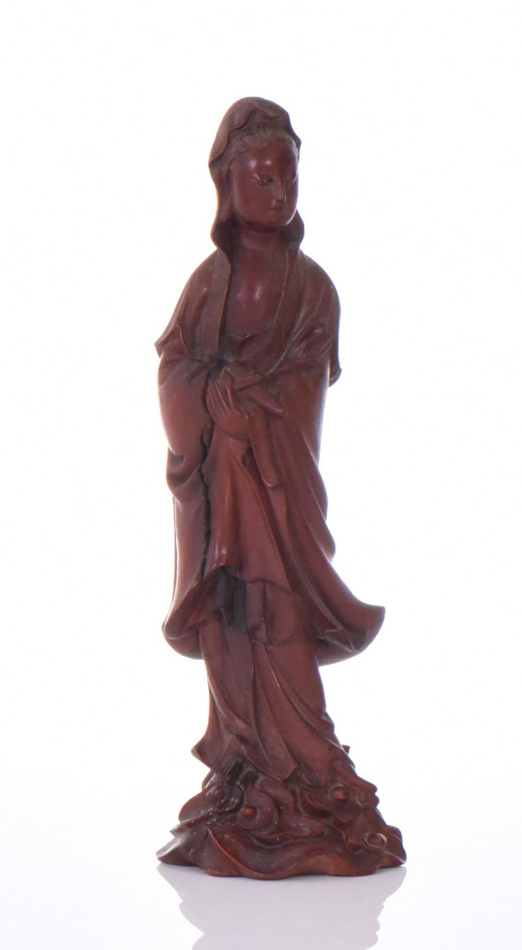 A Finely Carved Wood Guanyin Sculpture. The Go